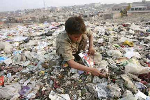 Poverty facts: kid with garbage